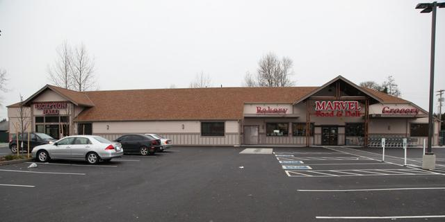 Photo of the building in Tacoma store with parking lot